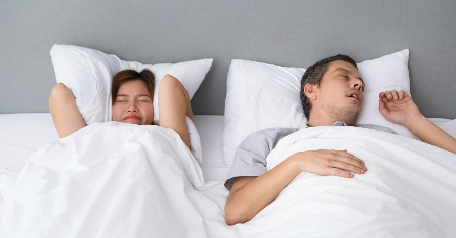 Man and woman sleeping in the bed