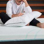 Man with Tempur-Pedic Pillows at yhe bed