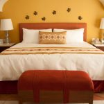 king size bed in orange room
