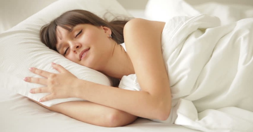 a-girl-sleeping-on-a-pillow